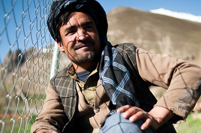Haji Abdul Rahim sits beside his fruit nursery, which will produce adaptive fruit saplings for distribution in Jawzari communities, bringing in money and raising his community's standard of living. Photo: UNDP Afghanistan / Rob Few / 2015